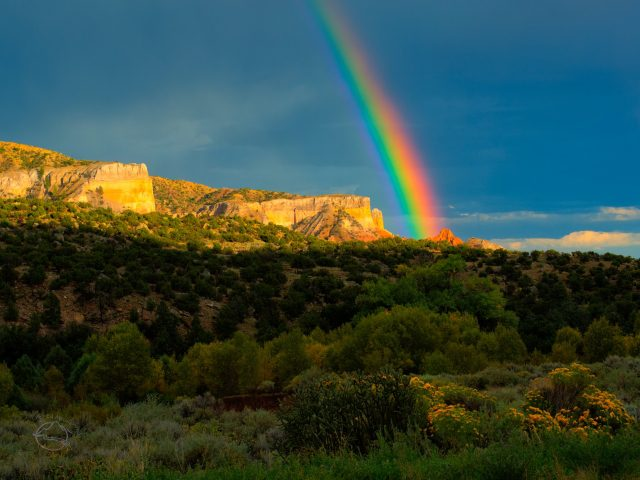 Rainbow over sandstone cliffs in Georgia O'Keefe country, New Mexico.