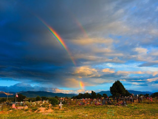 Rainbow over the cemetery at Truchas, New Mexico
