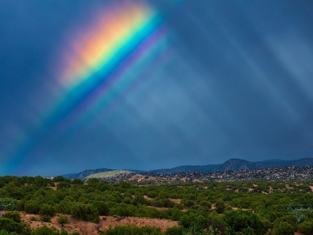 Rainbow with supernumerary bows and anti-crepuscular rays over Santa Fe